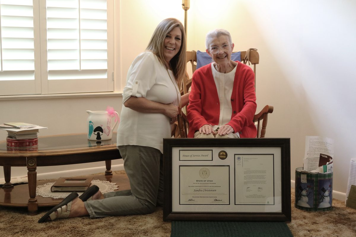 LaDawn Stoddard (left) presenting Sandra Christensen with the Power of Service Award on July 17, 2018