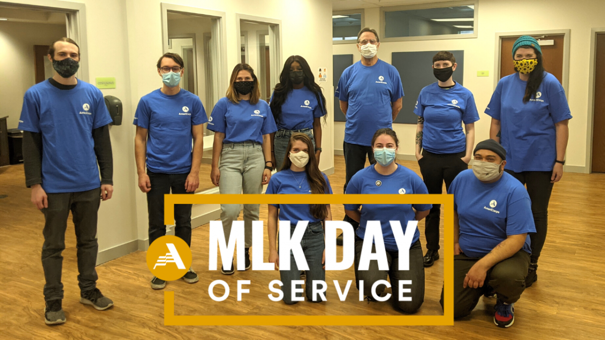 Image of 10 AmeriCorps members in blue shirts. MLK Day of Service logo on top of image