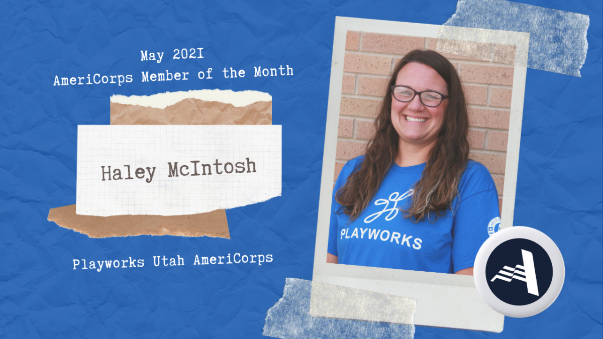 May 2021 AmeriCorps Member of the Month - Haley McIntosh. Image of Haley, a woman with brown hair wearing glasses standing in front of a red brick wall. She is wearing a blue shirt with the Playworks logo.
